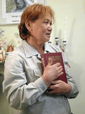 Buston holds her Russian Bible, which was a gift from the staff at Hope Center.