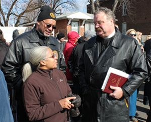 "LCMS President Rev. Dr. Matthew C. Harrison, right, talks with Carmen and Eddie Gamble, residents of St. Louis' College Hill neighborhood, during the March 20 groundbreaking there for Lutheran Housing Support's ""Nazareth Homes."" (LCMS Foundation/Blake Tilley)"
