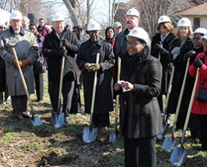 "Nicole Ridley, foreground, thanks residents, city officials, supporters and volunteers during the March 20 groundbreaking for ""Nazareth Homes"" in St. Louis' College Hill neighborhood.  Among those breaking ground were, from far left, LCMS Missouri District President Rev. Dr. Ray Mirly, Lutheran Church Extension Fund President and CEO Rich Robertson, and Synod President Rev. Dr. Matthew C. Harrison, fourth from left. (LCMS Foundation/Blake Tilley)"