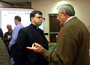 The Rev. Dr. Allan Buckman, right, chairman of Christian Friends of New Americans, talks with the Rev. Ted Krey, regional director for Latin America and the Caribbean with the Synod's Office of International Mission, during the annual conference of the Association of Lutheran Mission Agencies. (LCMS Communications/Paula Schlueter Ross)
