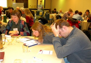 Participants at the conference of the Association of Lutheran Mission Agencies pray for one another's ministries. (LCMS Communications/Paula Schlueter Ross)