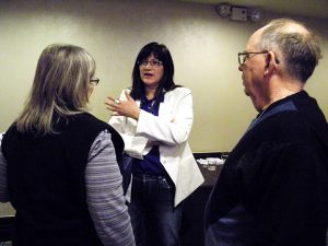 """Patricia Main, center, co-director of campus ministry at Haskell Indian Nations University in Lawrence, Kan., talks with attendees after leading a session at the Association of Lutheran Mission Agencies conference. So many of the students she serves """"have a story,"""" Main said, and """"just want somebody to listen to them."""" (LCMS Communications/Paula Schlueter Ross)"""