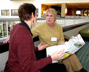 Dawn Mueller, left, of the Children's Christian Concern Society talks with Rita Nickel of Lutherans in Medical Missions during a break at the 2013 ALMA conference. (LCMS Communications/Paula Schlueter Ross)