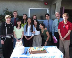 """Nine of the 16 graduating seniors at Pacific Lutheran High School in Torrance, Calif., pose for a photo during the school's National Honor Society (NHS) induction ceremony March 14. Three of the NHS students are considering attending Concordia University System schools in Irvine, Calif., and Bronxville, N.Y., through the """"Concordia Choice"""" program. Also in the photo are teachers Mary Flett, left, and Gale McKim, second from right. (Rebekah Lieu)"""