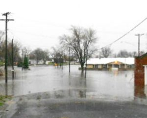 Floodwaters surround buildings in Roanoke, Ill., after the rain-swollen Panther Creek overflowed on April 17, 2013. (Trinity Lutheran Church/Julie Ludeman)