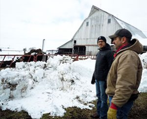 """First-year seminarian Aaron Spratt, left, and Don Schlesselman discuss agribusiness during a visit to the Schlesselman family farm near Concordia, Mo., as part of LCMS Rural and Small Town Mission's first """"Rural Immersion"""" event. (Amy Gerdts)"""