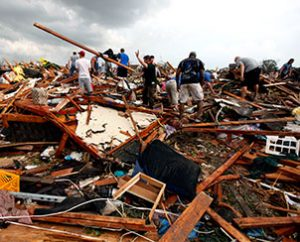 Workers look for victims under debris from the May 20 tornado that roared through the Oklahoma city suburbs, flattening entire neighborhoods. As of May 21, LCMS Disaster Response staff were assessing how the Synod can support the town's ongoing relief needs. (AP Photo/The Oklahoman, Paul Hellstern)