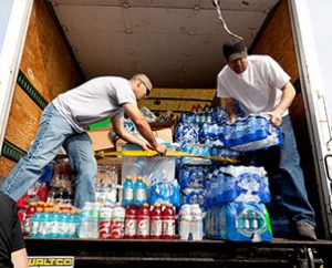 Workers unload donations of drinking water and other supplies at St. John's Lutheran Church in Moore, Okla., on May 24, 2013. (Dan Gill)