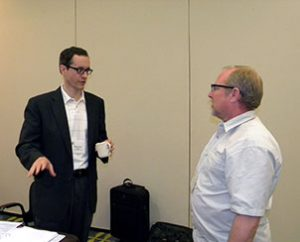 The Rev. Thomas Engler, left, continues a discussion on policy with Dr. James Tallmon during a break at the June meeting of the Board for National Mission. Both men serve on the board. (LCMS Communications/Megan Mertz)