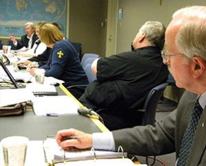 The Dr. William Meyer, left, who was president of the Concordia University System (CUS) from 2002 to 2005, addresses Floor Committee 5 for Seminary and University Education, chaired by the Rev. Dr. Dale Sattgast, right, president of the LCMS South Dakota District. Meyer continues to serve part time with CUS in his retirement. (LCMS Communications/Joe Isenhower Jr.)