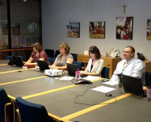 """From left, LCMS Communications staff members Becky Cummings, Vicki Biggs and Adriane Dorr assist the Rev. Bart Day, executive director of the LCMS Office of National Mission, with the """"Twitter chat"""" on marriage, June 19 at the Synod's International Center in St. Louis.  (LCMS Communications/Melanie Ave)"""