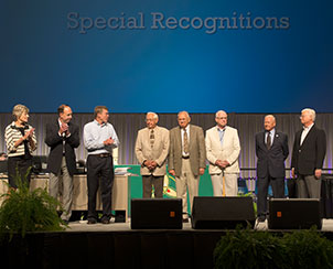 Newly elected members of the Synod Board of Directors, left, join the convention in thanking outgoing members, at right, for their service to the church. (LCMS Communications)