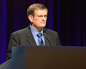 The Rev. Richard Boche, chairman of Floor Committee 7, presents resolutions to convention delegates.