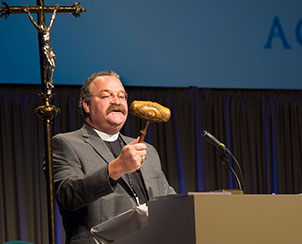 LCMS President Rev. Dr. Matthew C. Harrison describes the historic gavel before using it to formally open the first business session of the 65th Regular Convention of The Lutheran Church—Missouri Synod on Sunday, July 21. The intricately carved gavel bears the likenesses of Martin Luther and C.F.W. Walther, the Synod's first president, and has been used at every Synod convention since 1911. (LCMS Communications)
