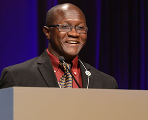The Rev. James Kollie greets convention delegates on behalf of the Evangelical Lutheran Church of Liberia. (LCMS Communications)
