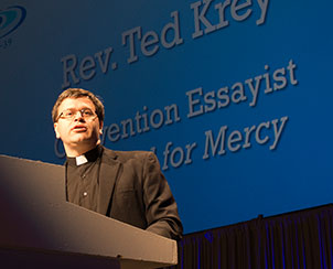 "The Rev. Ted Krey delivers the third of four convention essays, ""Baptized for Mercy,"" Tuesday at the 65th Regular Convention. (LCMS Communications)"