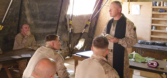 Chaplain Mike Sneath conducts a service in Afghanistan.