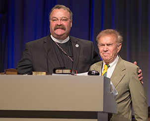 The Rev. Dr. Matthew C. Harrison thanks outgoing LCMS Third Vice-President Rev. Dr. Paul L. Maier for his many years of service to the church. (LCMS Communications)