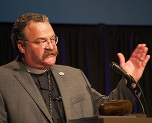 """Newly re-elected LCMS President Rev. Dr. Matthew C. Harrison urges participants at the 65th Regular Convention of The Lutheran Church—Missouri Synod to """"listen to blessings of the past"""" as """"we face severe challenges as a church."""""""