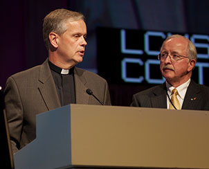 The Rev. Dr. Glen Thomas, the Synod's executive director of pastoral education, and LCMS South Dakota District President Rev. Dr. Dale Sattgast present three resolutions from Floor Committee 5.