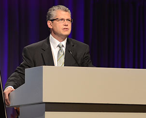 The Rev. Dr. James Baneck, chairman of the 2013 LCMS convention floor committee on Witness, gives an overview of some of the resolutions that will be brought before the convention. (LCMS Communications)