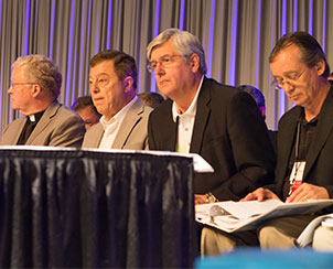 Members of Floor Committee 1 listen to comments from the floor during the final day of the 2013 LCMS convention. (LCMS Communications)