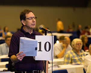 A delegate speaks to a resolution presented from Floor Committee 5 Seminary and University Education.