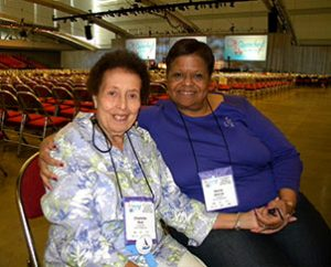 """""""Unsung Hero"""" Charlotte Reid, left, poses for a photo with her friend Dorrie Aldrich in the convention hall. Aldrich described Reid, 90, as """"very committed and very involved in serving others."""" Both are members of Mount Olivet Lutheran Church in Washington, D.C. (LCMS Communications/Paula Schlueter Ross)"""