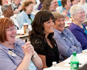 Lutheran Women's Missionary League members share a light moment during the convention. During business sessions, delegates adopted a record mission-grant goal of $1.83 million. (Lutheran Women's Missionary League/BBM Photo)
