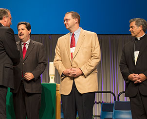 From left, Rev. Peter Prange of the Wisconsin Evangelical Lutheran Synod, Rev. Dr. Lawrence Welch of the Roman Catholic Archdiocese of St. Louis and Rev. David Wendel of the North American Lutheran Church are greeted by LCMS President Rev. Dr. Matthew C. Harrison. (LCMS Communications)