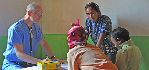 Mercy Medical Team volunteer Carl Jurgens, M.D., diagnoses a patient at a rural field clinic sponsored by LCMS Life and Health Ministries in Madagascar.