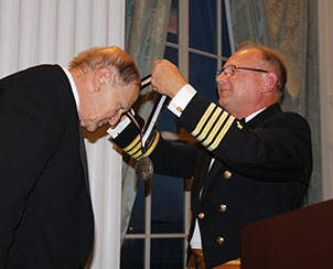 """Lt. Gen. Merle Freitag, former president of Lutheran Church Extension Fund, receives the Silver St. Martin of Tours Medal — """"the highest award our church body grants for exceptional, sustained meritorious service to God and country,"""" according to Chaplain Mark Schreiber (right), director of LCMS Ministry to the Armed Forces (MAF). The medal was presented during the MAF's Recognition Dinner, July 21 in St. Louis. (Ministry to the Armed Forces/Eric Erkkinen)"""
