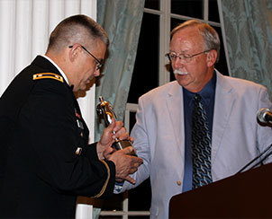 """Chaplain Lt. Col. Rev. Steven Hokana of Fort Bliss, Texas, accepts the Silver Telly Award July 21 for """"Warriors of Faith — Military Men,"""" a five-part Men's NetWork video Bible study he wrote and hosted. Presenting the award is Bruce Wurdeman, executive director of Lutheran Hour Ministries, which produced the award-winning video. (Ministry to the Armed Forces/Eric Erkkinen)"""