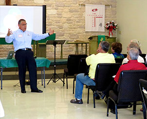 """The Rev. Eloy Gonzalez shares about Hispanic outreach successes from Our Redeemer Lutheran Church in Irving, Texas, during the """"What's Working in Hispanic Ministry"""" conference Aug. 24 at Iglesia Luterana Cristo Nuestro Salvador in San Antonio. (LCMS Texas District)"""