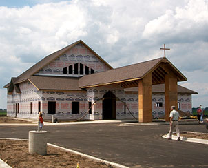 Construction of the new Risen Savior Evangelical Lutheran Church facility in Manteno, Ill., is right on schedule despite a June 12 storm that destroyed the building project. The cross atop the entrance was made from wood salvaged from the storm debris. (Risen Savior Evangelical Lutheran Church)