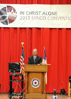 The Rev. Mark Schroeder, president of the Wisconsin Evangelical Lutheran Synod, addresses delegates and guests during the church body's 62nd Biennial Convention. (William A. Pekrul/Martin Luther College Public Relations)