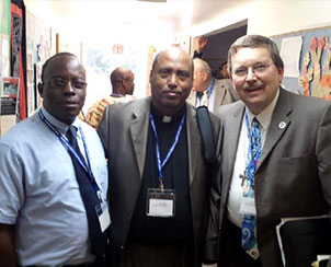 Posing for a photo at the Synod's first national African-immigrant ministry conference are, from left, the Rev. Philip Saywrayne, Staten Island, N.Y., vice-president of African Lutheran Mission in the Americas (ALMIA); the Rev. Dr. Getachew Kiros of Los Angeles, ALMIA president; and the Rev. Dr. Herbert Mueller Jr., first vice-president of the LCMS. (African Lutheran Mission in the Americas)
