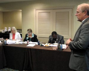 The Rev. John A. Fale, associate executive director of LCMS Mercy Operations, presents a new policy on extending calls to those endorsed for Specialized Pastoral Ministry (SPM) to the LCMS Board for National Mission at its meeting Sept. 12-13 in St. Louis. The board will now serve as the calling agency for SPM pastors. (LCMS Communications/Melanie Ave)