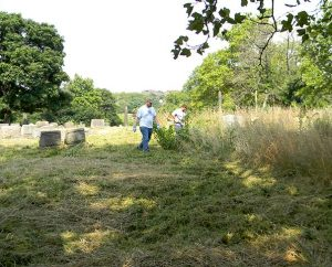 Many of the gravesites in the LCMS-owned Minersville Cemetery in Pittsburgh were not visible because of high weeds before a cleanup effort this summer. Volunteers from area Lutheran churches began a restoration of the cemetery in July and are now raising funds for more improvements. (Cheryl D. Naumann)