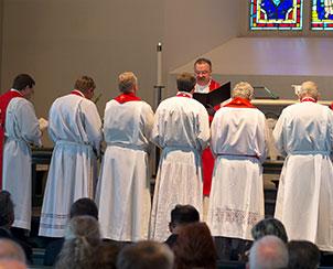 Immediately after his installation, LCMS President Rev. Dr. Matthew C. Harrison installs the Synod's six vice-presidents. From left, in order, from first through sixth vice-presidents, are the Rev. Dr. Herbert C. Mueller Jr., the Rev. Dr. John C. Wohlrabe Jr., the Rev. Daniel Preus, the Rev. Dr. Scott R. Murray, the Rev. Nabil S. Nour and the Rev. Dr. Robert T. Kuhn. (LCMS Communications)