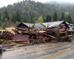 Debris from the floodwaters almost obscures the Town Hall in Glen Haven, Colo. As of Oct. 11, 2013, the Synod's Rocky Mountain District had distributed $7,600 in grants to provide gift cards, cash and supplies to families with flood damages. (Rocky Mountain District/Doug Ullmann)