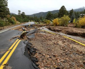 A yellow gas line lies atop the mud and gravel of a flood-destroyed road in Estes Park, Colo. LCMS Disaster Response and the Rocky Mountain District are working to help congregations respond to the needs of local flood victims. (LCMS Disaster Response/Ross Johnson)