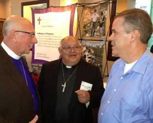 From left, the Rev. Dr. David Benke, president of the LCMS Atlantic District; the Rev. Dr. Carlos Hernandez, director of LCMS Church and Community Engagement; and the Rev. Mark Mueller, pastor at Bethlehem Lutheran Church in Delmar, N.Y., talk during the 5th LCMS National Disaster Response Conference in St. Louis. Presentations included one by Benke on the district's role in natural disasters. (LCMS Communications/Al Dowbnia)