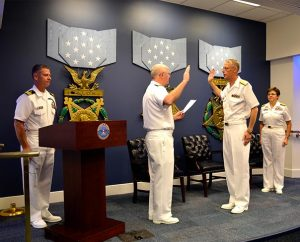 Rear Admiral Mark Tidd, chief of chaplains (left, center), administers the oath for Rear Admiral Daniel L. Gard. (LCMS Communications)
