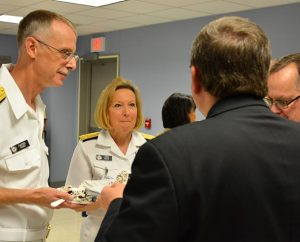 From left, Rear Admiral Rev. Daniel L. Gard; Vice Admiral Robin Braun, an LCMS member; LCMS First Vice-President Rev. Dr. Herbert C. Mueller Jr.; and Concordia Theological Seminary Dean of Students Rev. Tom Zimmerman share stories following Gard's promotion to Rear Admiral. (LCMS Communications)