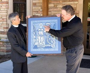 The Rev. Yutaka Kumei, president of the Japan Lutheran Church, left, presents a gift to LCMS President Rev. Dr. Matthew C. Harrison during the Service of Installation Sept. 14 at Concordia Seminary, St. Louis. The biblical print by Sadao Watanabe depicts the Holy Spirit descending on Jesus Christ at His Baptism. (LCMS Communications/Michael Schuermann)