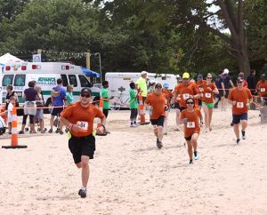 """Employees of Concordia Plan Services — named one of St. Louis' """"Healthiest Employers"""" for 2013 — participate in the Ragnar Rally, a 32-hour, 200-mile race from Madison, Wis., to Chicago. (Concordia Plan Services/Nicki Kirk)"""