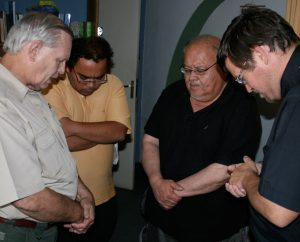 From left, LCMS Director of Disaster Response Rev. Glenn Merritt; ILC-Chile pastor the Rev. Alejandro Lopez; the Rev. Dr. Carlos Hernandez, director of LCMS Church and Community Engagement; and ILC-Chile President Rev. Cristian Rautenberg pray at the end of a meeting to plan the best ways to show mercy to those affected by the 2010 earthquake in Chile.