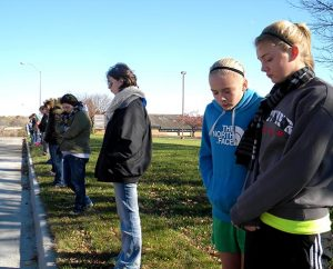 Youth attending the Lutherans For Life (LFL) national conference in Urbandale, Iowa, pray silently outside the local Planned Parenthood facility on Nov. 8. The group included members of two campus pro-life organizations — Bulldogs for the Unborn at Concordia University Nebraska, Seward, and Students for Life at Concordia University Wisconsin, Mequon — as well as a Council Bluffs, Iowa, high school. (LCMS Communications/Paula Schlueter Ross)