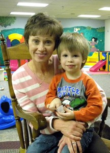 New Lutherans For Life (LFL) President Lynette Auch poses with her grandson Isaac in the childcare facility at Gloria Dei Lutheran Church in Urbandale, Iowa. The congregation hosted LFL's 2013 national conference. (LCMS Communications/Paula Schlueter Ross)